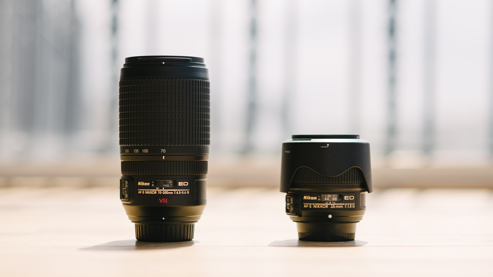 two lenses for full-frame cameras: nikkor 70-300mm f/4.5-5.6 and nikkor 35mm f/1.8