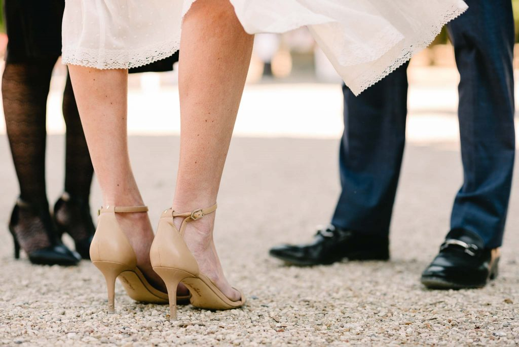Detail photo of shoes and legs during an outdoor elopement in Paris, France