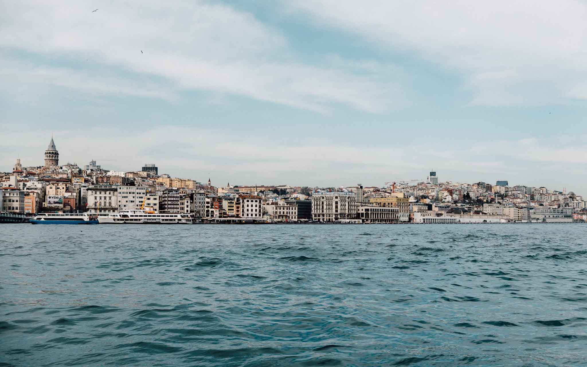 Calming photo of Istanbul taken from the Bosphorus Strait with muted colors