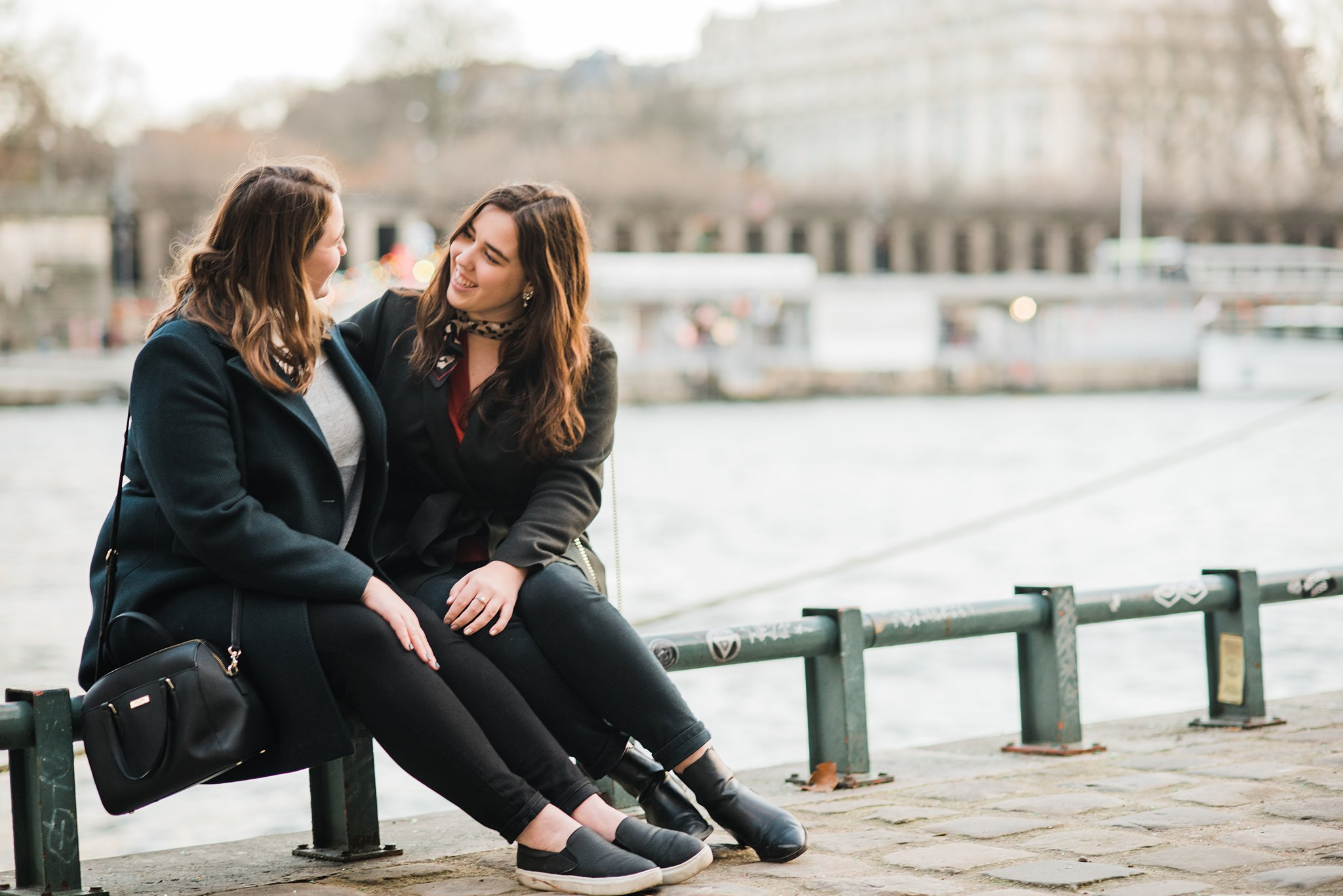 sisters by the seine river in paris france