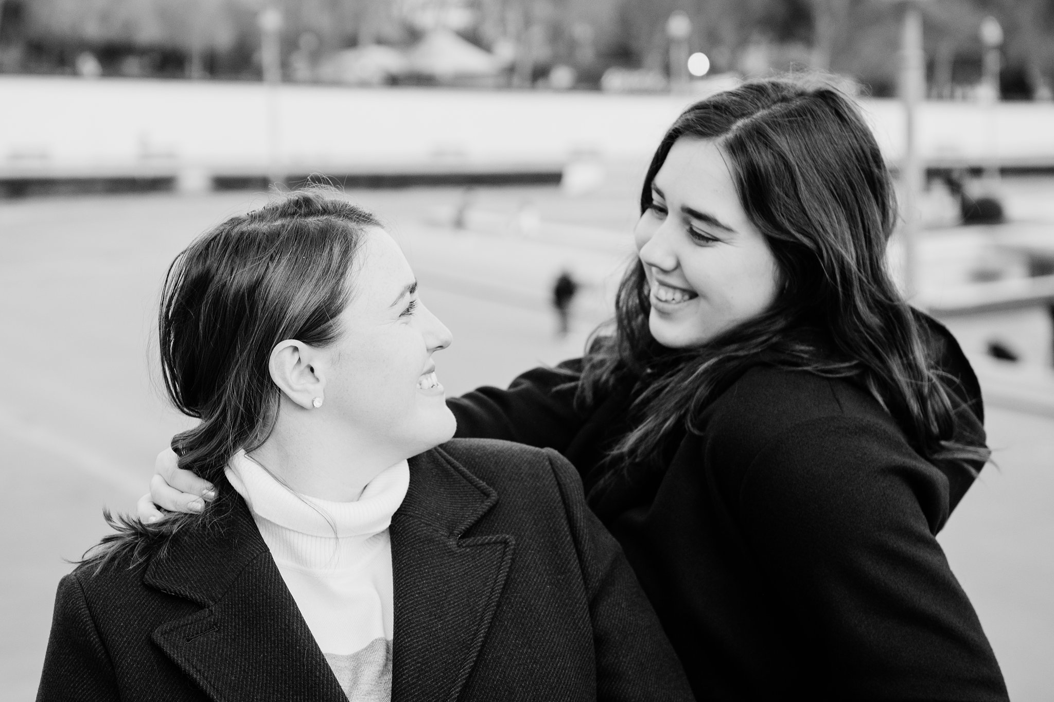 Black and white photo of sisters looking at each other during a photo shoot in Paris in December