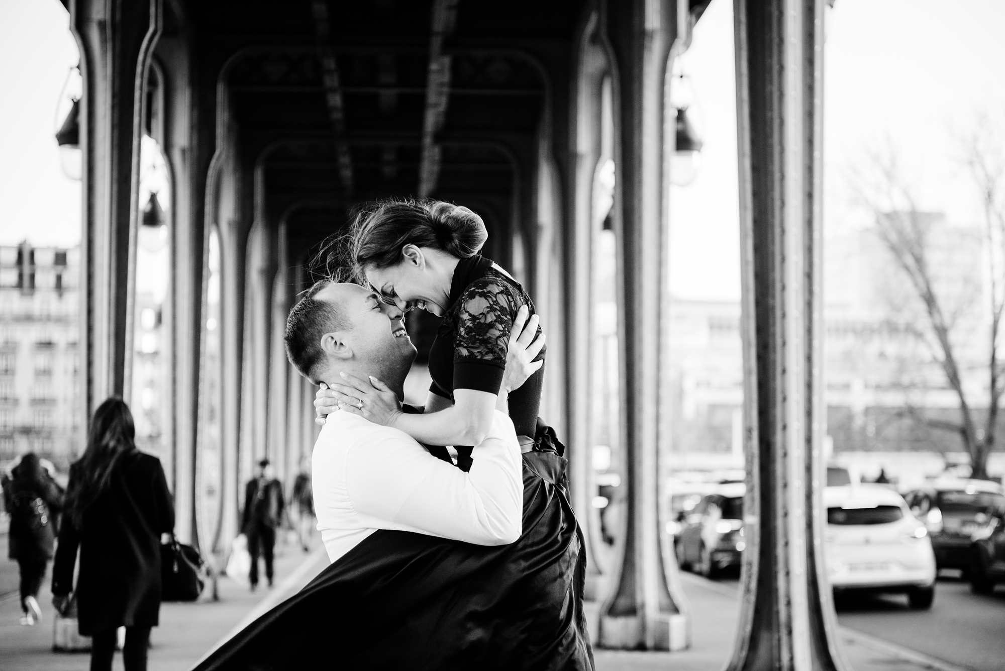 Jennifer and Yannick's Surprise Paris Proposal Photo Shoot at the Eiffel Tower - at the bir-hakeim bridge in black and white