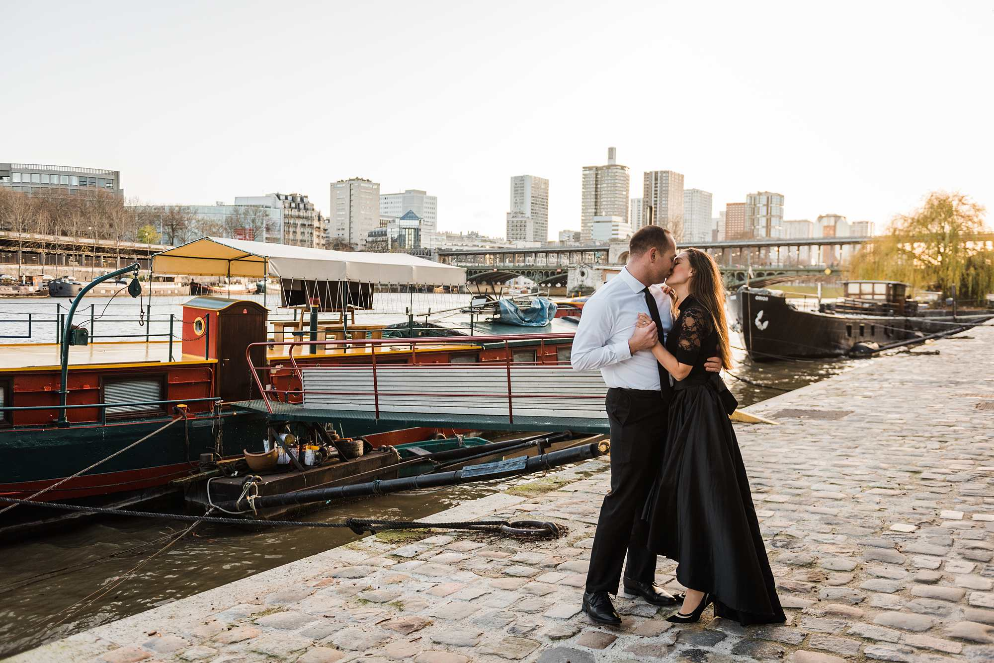 Jennifer and Yannick's Surprise Paris Proposal Photo Shoot at the Eiffel Tower - dancing together and kissing by the seine river