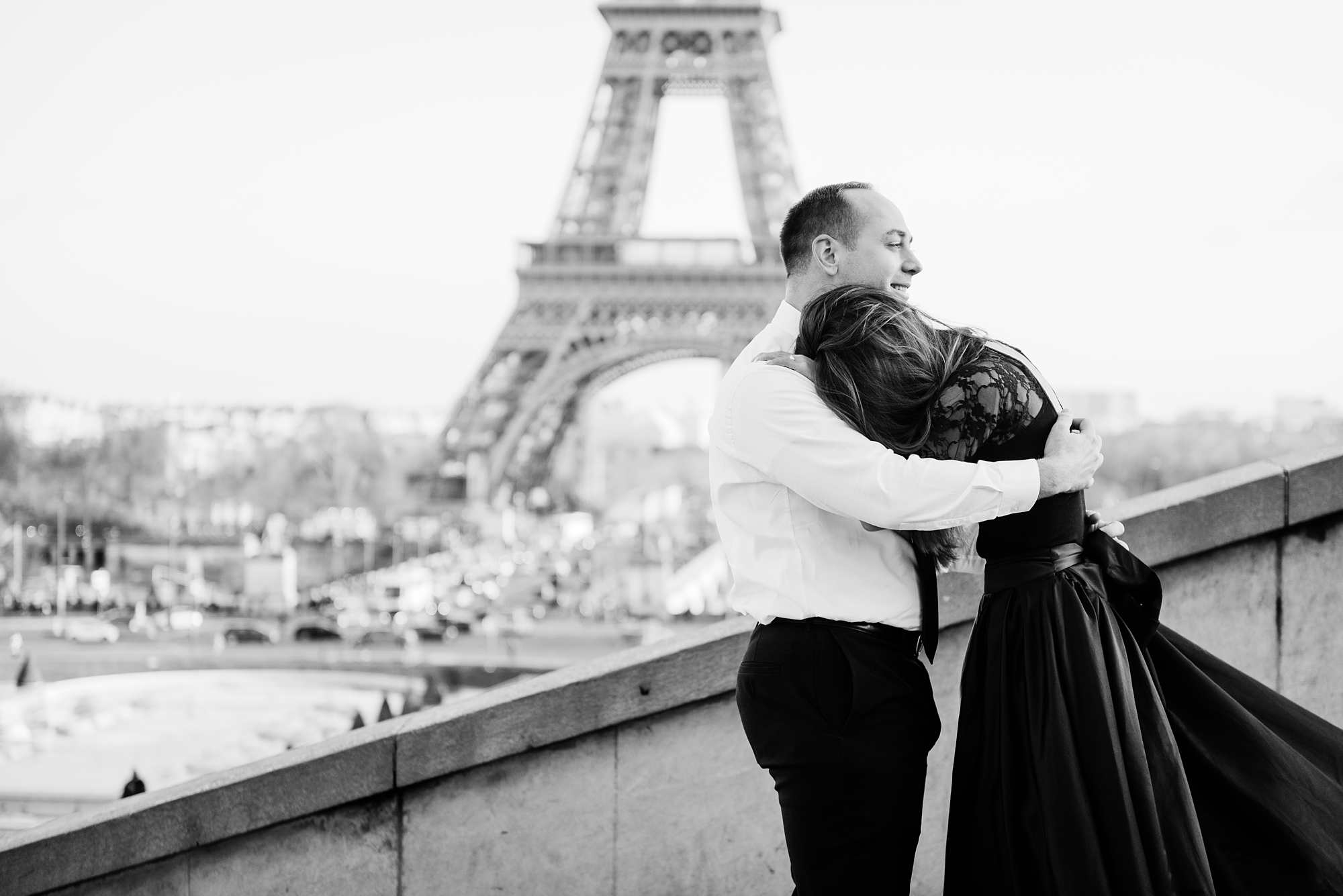 Jennifer and Yannick's Surprise Paris Proposal Photo Shoot at the Eiffel Tower - the hug when she says yes