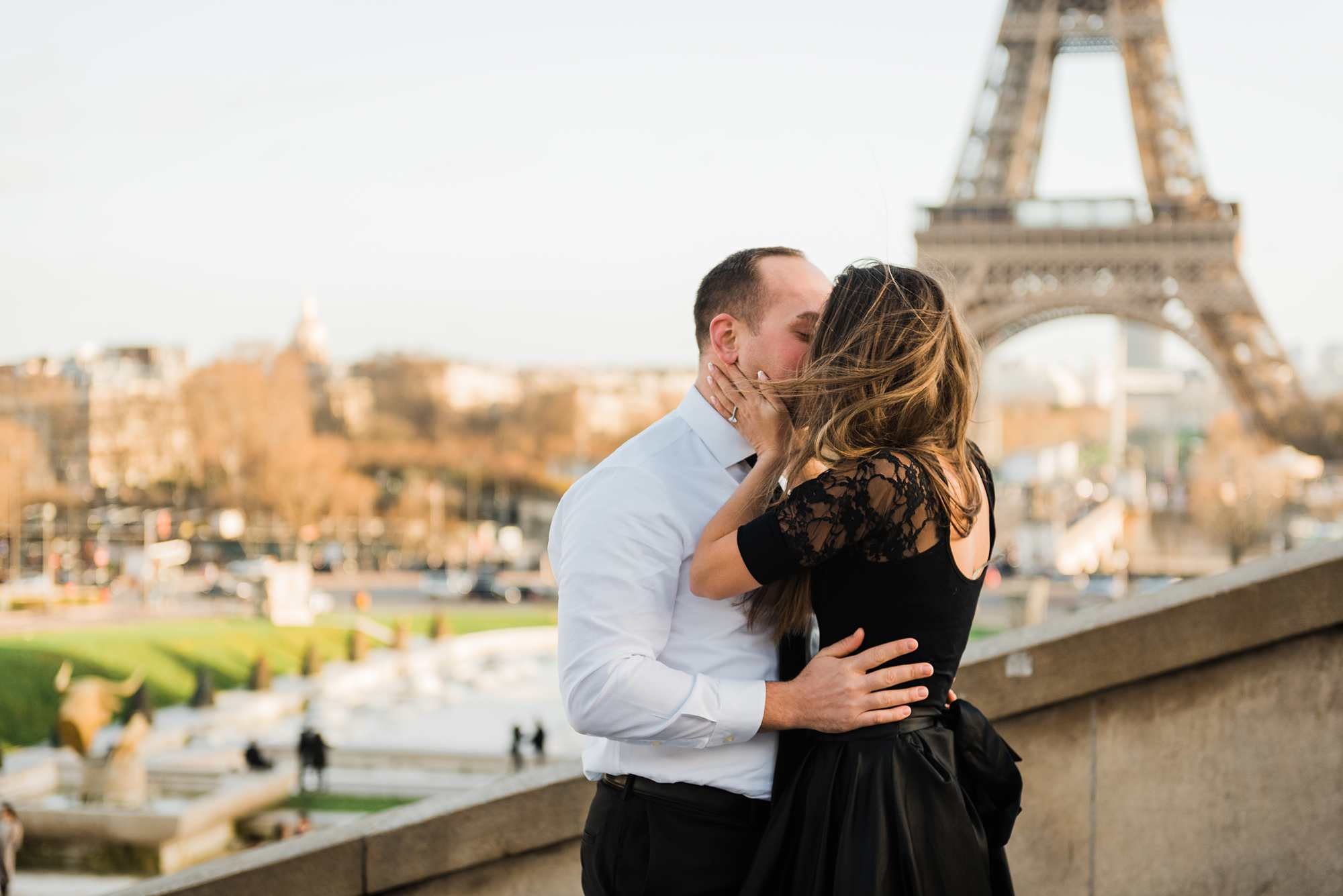proposal photographer in paris france couple in love kissing in front of eiffel tower