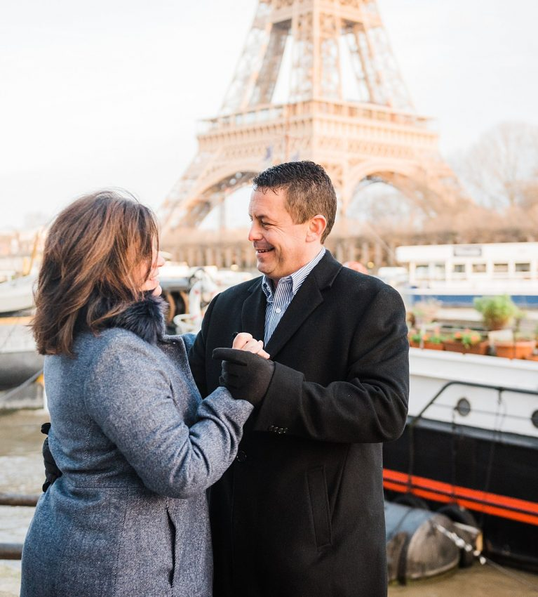 professional photography in paris france - couple dancing together by the seine river on an anniversary photoshoot