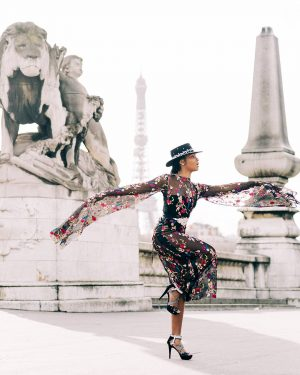 Print for Sale on Paige Gribb Photography - Asja in Motion - A woman in a black embroidered floral dress in front of the Eiffel Tower in Paris, France taken during Paris Fashion Week